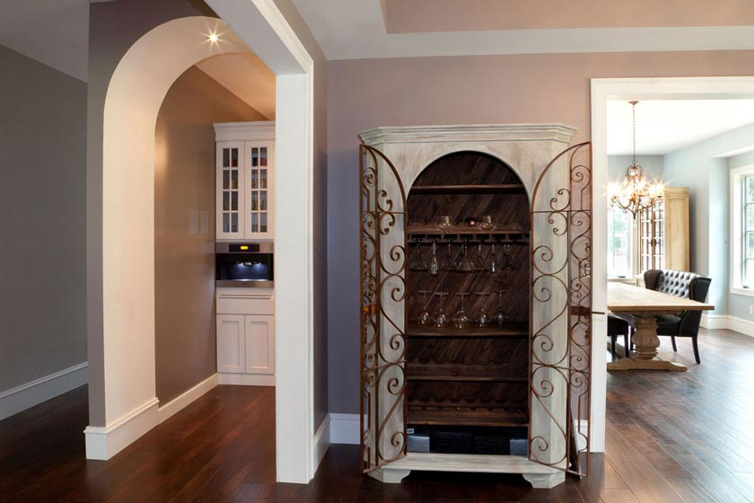 The Dining Room A Beverage Cooler And Ice Maker Frosted Glass Door Which Brings In Lots Of Natural Light Is Close To Side Exterior